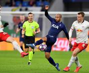 Tottenham Hotspur's English midfielder Ryan Sessegnon (L) and Leipzig's US midfielder Tyler Adams vie for the ball during the UEFA Champions League football match between RB Leipzig and Tottenham Hotspur, in Leipzig, eastern Germany on March 10, 2020.  /